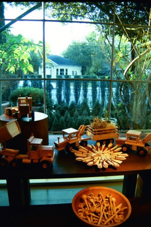 Visual Merchandising 'Gardens' Retail Shop, Austin, Texas Wooden Trucks and Utensils in Front Window